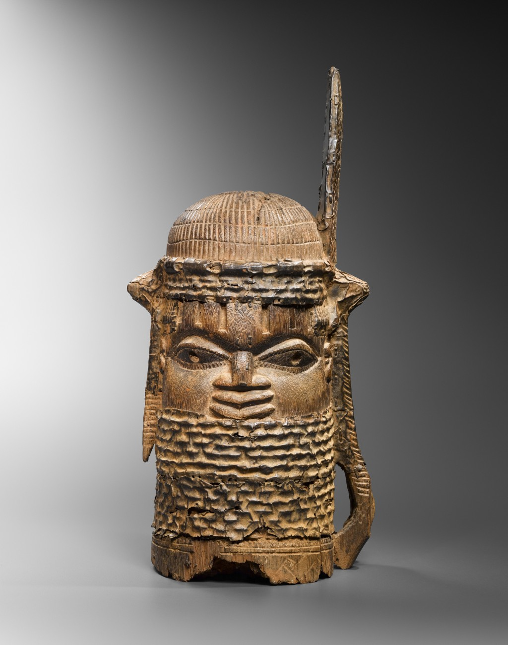 Benin head, Nigeria Wood and metal - height 54 cm Provenance: Old European Collection